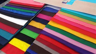 پارچه تریکو ملانژ رنگی